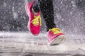 stock photo of cold-weather  - Athlete woman is running during winter training outside in cold snow weather - JPG
