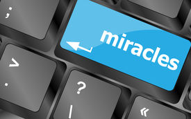picture of qwerty  - Computer keyboard key button with miracles text - JPG