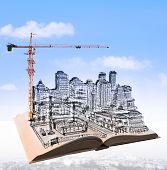 picture of sketch book  - sketching of building construction on flying book over urban scene use for civil engineering and land development topic - JPG