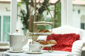 picture of eclairs  - Tea time in glass house with Eclair and biscuit - JPG
