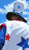image of uncle  - Uncle sam standing tall among the clouds outside - JPG