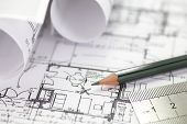 picture of engineering construction  - Architect rolls and plans construction project drawing - JPG