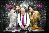 stock photo of grandpa  - amazing grandpa DJ and his two beauitful gogo dancers - JPG