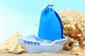 stock photo of sloop  - Blue toy ship on sand - JPG