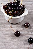 stock photo of black-cherry  - Close up of a bowl with black cherries - JPG
