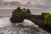 picture of greenery  - Asian temple on a rock coming into the ocean with greenery - JPG
