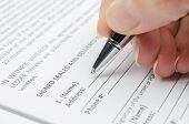 pic of deed  - Female hand with pen filling document close up - JPG
