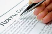 pic of rental agreement  - Female hand with pen filling rental contract - JPG