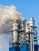 stock photo of chimney  - Smoke clouds from a chimney against blue sky - JPG