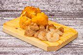 stock photo of chanterelle mushroom  - chanterelle mushrooms on a white wooden table - JPG