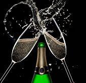 stock photo of flute  - Champagne flutes on black background - JPG