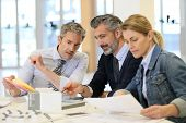 stock photo of real-estate-team  - Team of architects working on construction project - JPG
