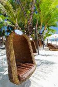 image of boracay  - Empty hanging wicker chair on tropical beach Philippines Boracay - JPG