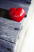 stock photo of heartfelt  - red heart on wooden table background - JPG