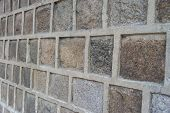 foto of cinder block  - Block concrete wall closeup in view side background - JPG