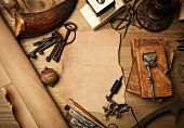 picture of wood pieces  - Piece of leather and tattoo machine on vintage wood desk - JPG