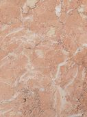 image of slab  - light pink marble stone with dark brown and gray streaks in a large heavy slab  - JPG