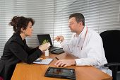 image of prophylactic  - a Pharmaceutical Sales Representative at hospital with a doctor - JPG