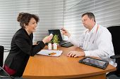 picture of rep  - a Pharmaceutical Sales Representative at hospital with a doctor - JPG