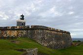 pic of el morro castle  - Lighthouse at Castillo San Felipe del Morro El Morro, San Juan, Puerto Rico. Castillo San Felipe del Morro is designated as UNESCO World Heritage Site since 1983. - JPG