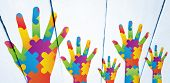 stock photo of autism  - Autism awareness hand against painted white wooden planks - JPG