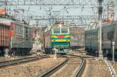 foto of passenger train  - Arrival and departure of the passenger trains at day time - JPG