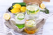 picture of cucumber  - Fresh water with lemon and cucumber in glassware on napkins - JPG