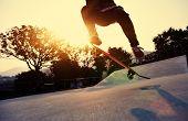 picture of skateboarding  - skateboarder riding on skateboard at skate park - JPG