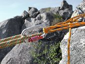 pic of mountain-climber  - Equipment for mountain climbing and rappelling close up - JPG