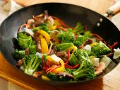 image of stir fry  - wok full of stirfry with selective focus - JPG