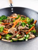 stock photo of stir fry  - colorful stir fry in a wok - JPG