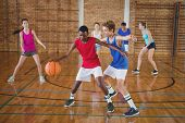 Determined high school kids playing basketball in the court poster
