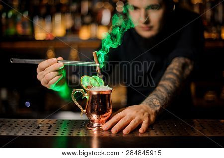 Professional Male Bartender Adding To