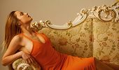 Glamour Girl Relax On Classy Sofa. Woman With Glamour Look. Sensual And Sexy. poster