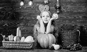 Gathering Harvest Traditions. Harvest Festival Concept. Child Girl Presenting Harvest Of Her Vegetab poster