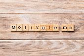 Motivate Me Word Written On Wood Block. Motivate Me Text On Wooden Table For Your Desing, Concept poster