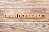 Stop Bullying Word Written On Wood Block. Stop Bullying Text On Wooden Table For Your Desing, Concep poster