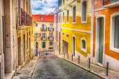 Lisbon, Portugal Street Perspective View With Colorful Traditional Houses poster