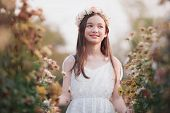 Portrait Of  Girl In A Flower Wreath,lovely Girl In Spring Flowers ,the Face Of A Smiling Girl Or A  poster