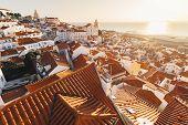 Sunrise Over Lisbon Old Town Alfama - Portugal. Lisbon Golden Hour Skyline. Sun Rising Over Tagus Ri poster