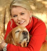 stock photo of middle-age  - A beautiful Middle aged Woman who Loves her Golden Retriever - JPG