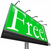 The word Free on a green background on an outdoor billboard sign advertisement to attract customers