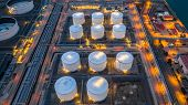 Oil Storage Tank, Gas Storage Tank At Night, Petrochemical Industrial, Aerial View Oil And Gas Stora poster