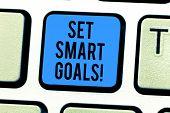 Conceptual Hand Writing Showing Set Smart Goals. Business Photo Text Establish Achievable Objectives poster