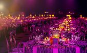 Pink And Purple Christmas Decor With Candles And Lamps For A Large Party Or Gala Dinner poster