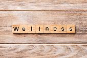 Wellness Word Written On Wood Block. Wellness Text On Wooden Table For Your Desing, Concept poster