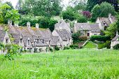 traditional Cotswold cottages in England, UK. Bibury is a village and civil parish in Gloucestershir poster