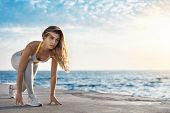 Motivated Attractive Fit Sporty Caucasian Sportswoman Low Start Pose Looking Forward Jogging, Runnin poster