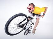 image of dirt-bike  - crazy boy on a dirt jump bike making funny faces - JPG