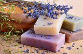 stock photo of salt-bowl  - Natural handmade soaps with salt and lavender flowers - JPG